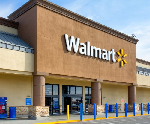 Walmart ups hourly wage to $11, adds benefits after tax overhaul