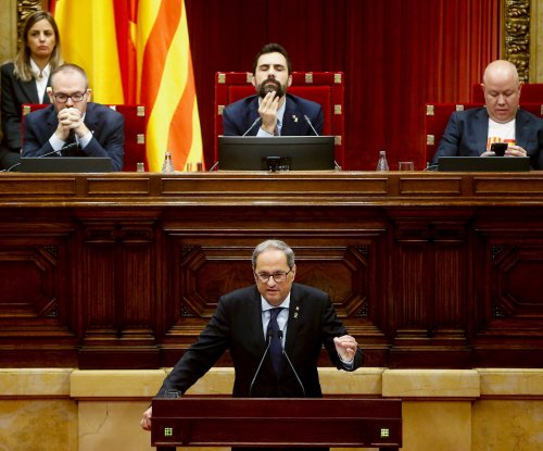 Catalan president seeks independence vote by 2021