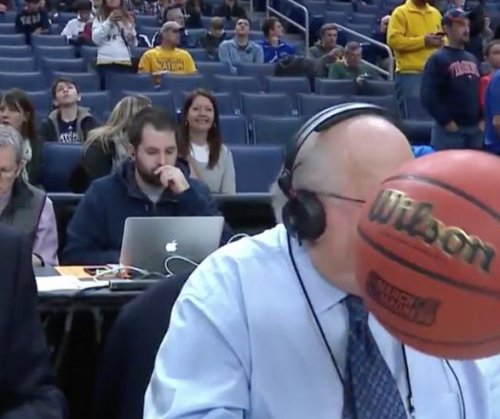 Watch: CBS broadcaster Verne Lundquist hit in face with basketball