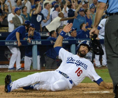Los Angeles Dodgers OF Andre Ethier (back) might miss Opening Day