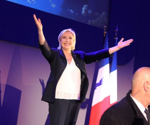 Le Pen, Macron advance to runoff in France's presidential election