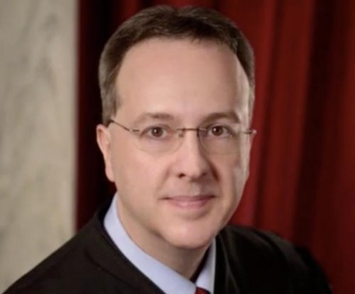 West Virginia high court justice indicted on 22 charges