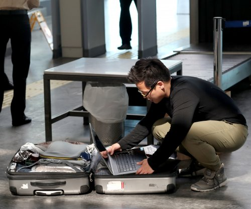 In-plane electronic device ban blamed on Islamic State