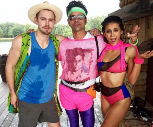 John Stamos attends Nina Dobrev's 80s-themed party
