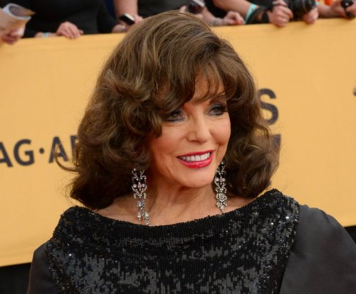 Joan Collins named a dame by Prince Charles