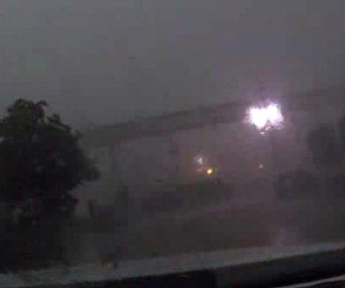 Wind blows train cars off bridge near New Orleans