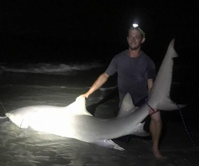 South Carolina fisherman reels in 9-foot lemon shark from shore