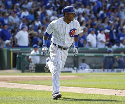 Chicago Cubs' Addison Russell sits out with sore shoulder