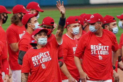 Cardinals beat Brewers; both teams clinch playoff spots