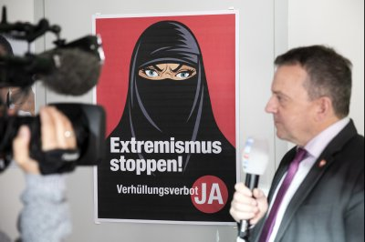 Switzerland votes to ban face coverings angering human rights, Muslim groups