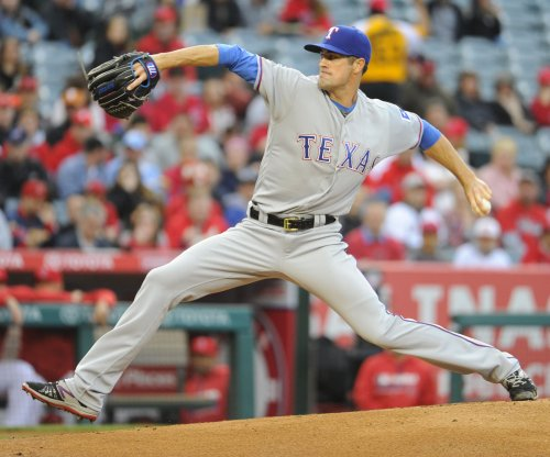 Cole Hamels pitches Texas Rangers to sweep of Houston Astros