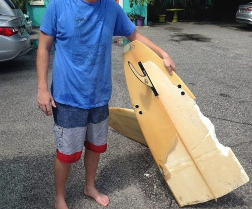South Carolina surfer says a shark bit his board in half