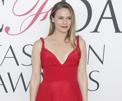 Alicia Silverstone goes nude for new PETA campaign: 'I'd rather go naked than wear wool'