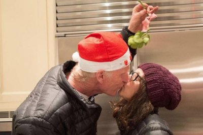 Julia Louis-Dreyfus shares mistletoe kiss with husband Brad Hall