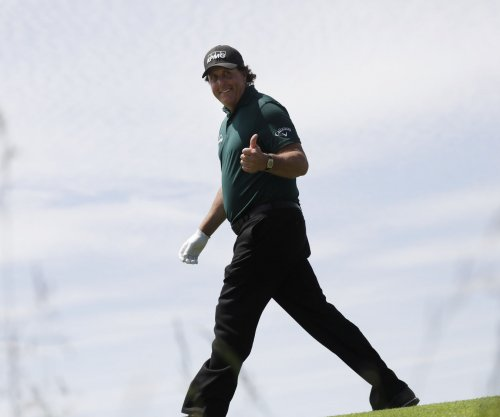 Phil Mickelson hits flop shot over fellow golfer's head from feet away