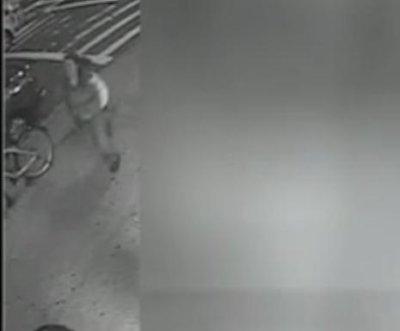 WATCH: Woman flees after pushing man onto subway tracks