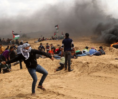 12 dead as Israelis, Palestinians clash in Gaza protest