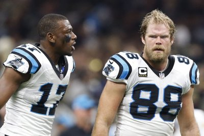 Carolina Panthers' Greg Olsen defends Cam Newton after Kelvin Benjamin comments