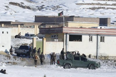 Taliban attack Afghan security compound, scores killed