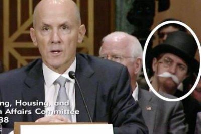 'Monopoly Man' sits behind former Equifax CEO at Senate hearing