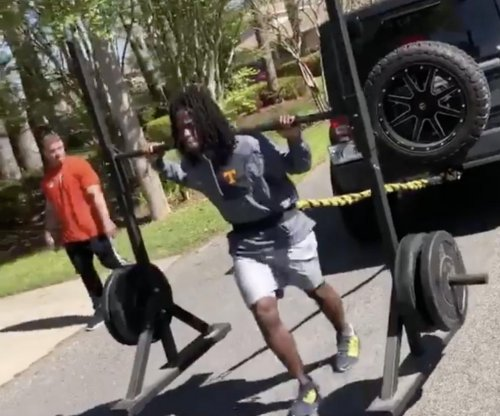 New Orleans Saints' Alvin Kamara drags Jeep during workout