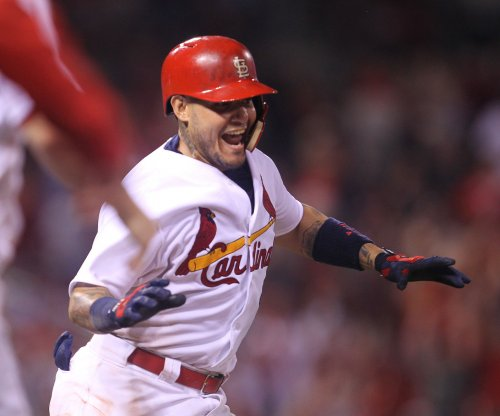 St. Louis Cardinals stun Reds with five runs in ninth