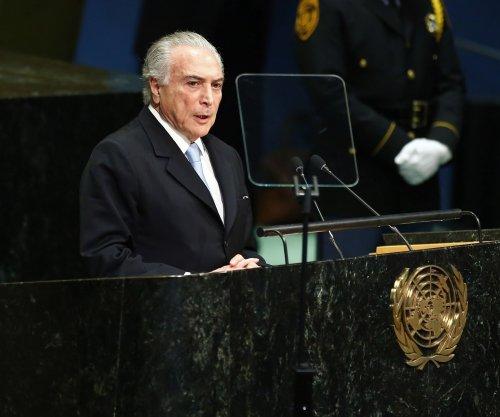 Brazilian president drops bid to suspend own corruption probe