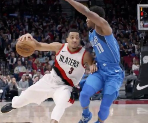 Blazers' McCollum drops Mavericks' Ferrell with crossover