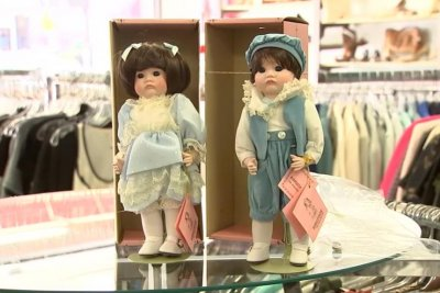 Thrift store worker finds $36,000 cash in doll box