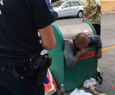 Spanish man rescued after falling into bin in search of old clothes