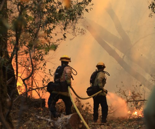 California fires: Crews gaining control; damage could top $3B