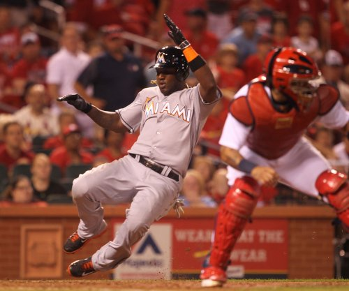 St. Louis Cardinals officially acquire OF Marcell Ozuna from Miami Marlins