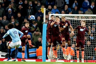 Leroy Sane leads Manchester City into Champions League round of 16