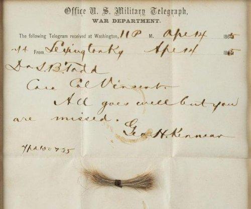 Lock of Abraham Lincoln's hair, 'bloody' assassination telegram sell for $81,250
