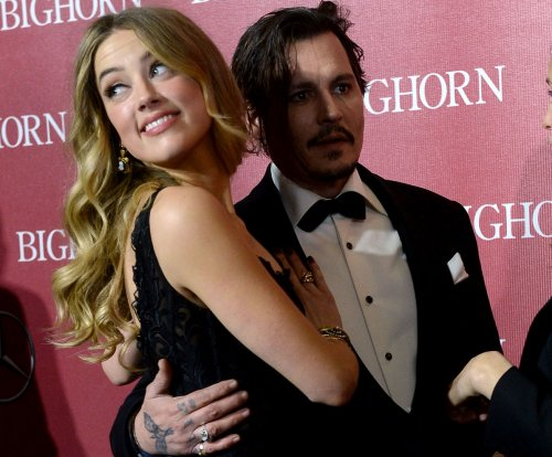 Johnny Depp changes Amber Heard tattoo from 'Slim' to 'Scum'