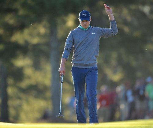 Masters: Jordan Spieth at top of leaderboard despite late struggles