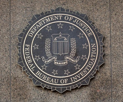 Ex-FBI agent admits stealing $136,000 in drug money for cars, cosmetic surgery