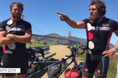 Doctors on tandem bike circle the globe in 218 days, 22 hours