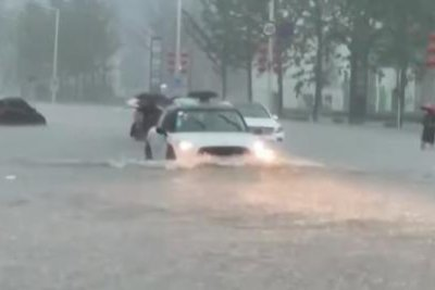 13 dead in central China amid flooding caused by heaviest rainfall in 1,000 years