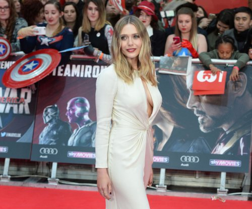Elizabeth Olsen and Emily VanCamp dazzle at the 'Captain America: Civil War' premiere