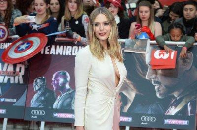 Elizabeth Olsen and Emily VanCamp dazzle at the 'Captain America: Civil War' premiere