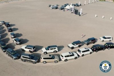 180 vehicles create falcon shape to set Guinness record