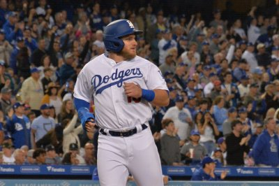 Dodgers hit six home runs in wild win over Rockies