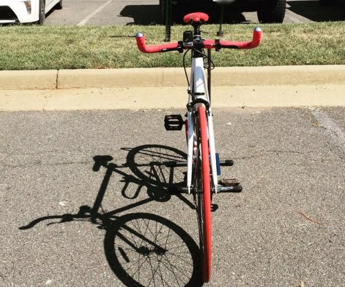 Washington Redskins' Alfred Morris bikes to work