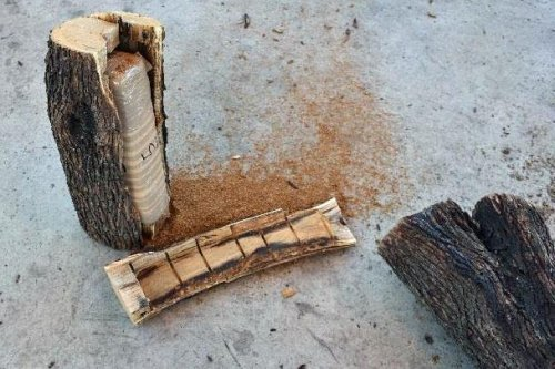 Over 100 pounds of marijuana found hidden in hollowed-out firewood