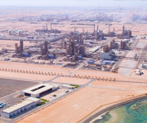 State oil ADNOC sells 35 percent in refining to Eni, OMV