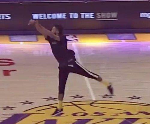 Los Angeles Lakers fan sinks half-court shot for $100K