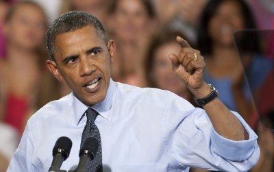 Obama: Reject Romney's snake oil
