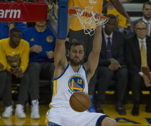 Golden State Warriors' Andrew Bogut, Harrison Barnes land with Dallas Mavericks