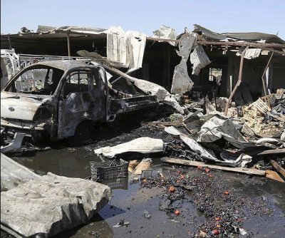 Suicide bombing targets people waiting in cars at Iraqi checkpoint; 18 dead